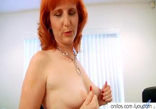 Redhead milf fucks hairy pussy
