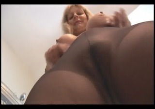 busty aged blonde in pantyhose and slip