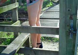 sexy in nature legged milf in high heels and mini