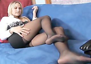 Busty blonde MILF teases in sheer black pantyhose
