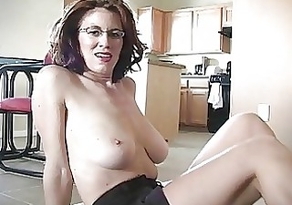 Sporty busty redhead momma works on her cock
