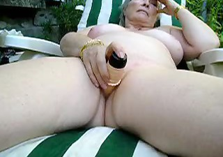 large titted mature doxy masturbates outdoor