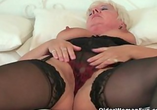 curvy granny in darksome nylons rubs her old