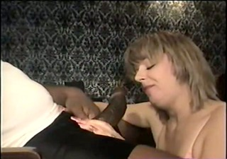 swinger wife eating the large black cock -